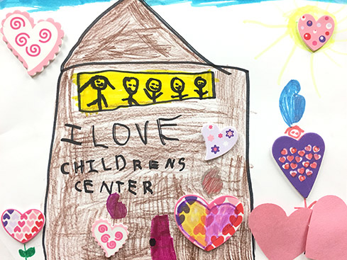 Childs drawing of a school that says I love Childrens Center